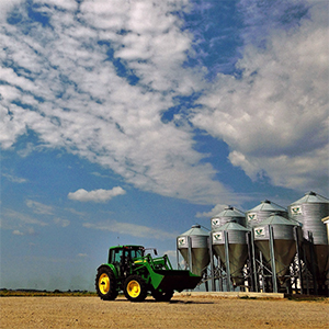 Tractor by grain bins