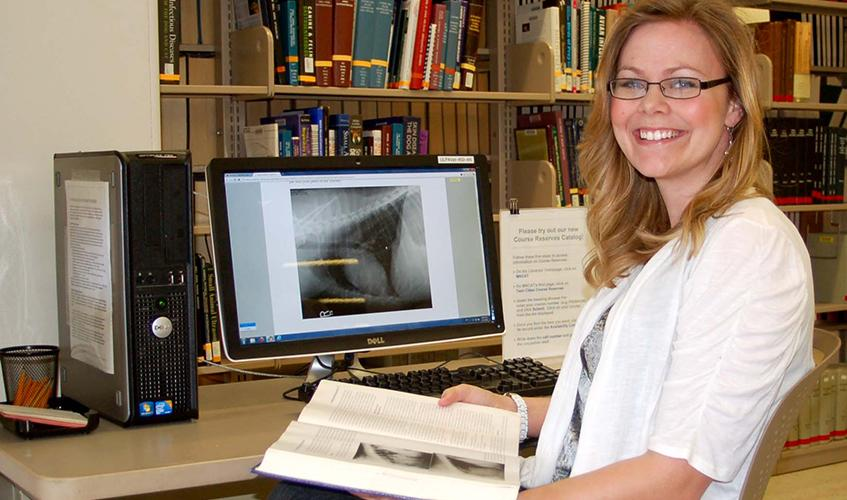 Student studying in the VetMed library