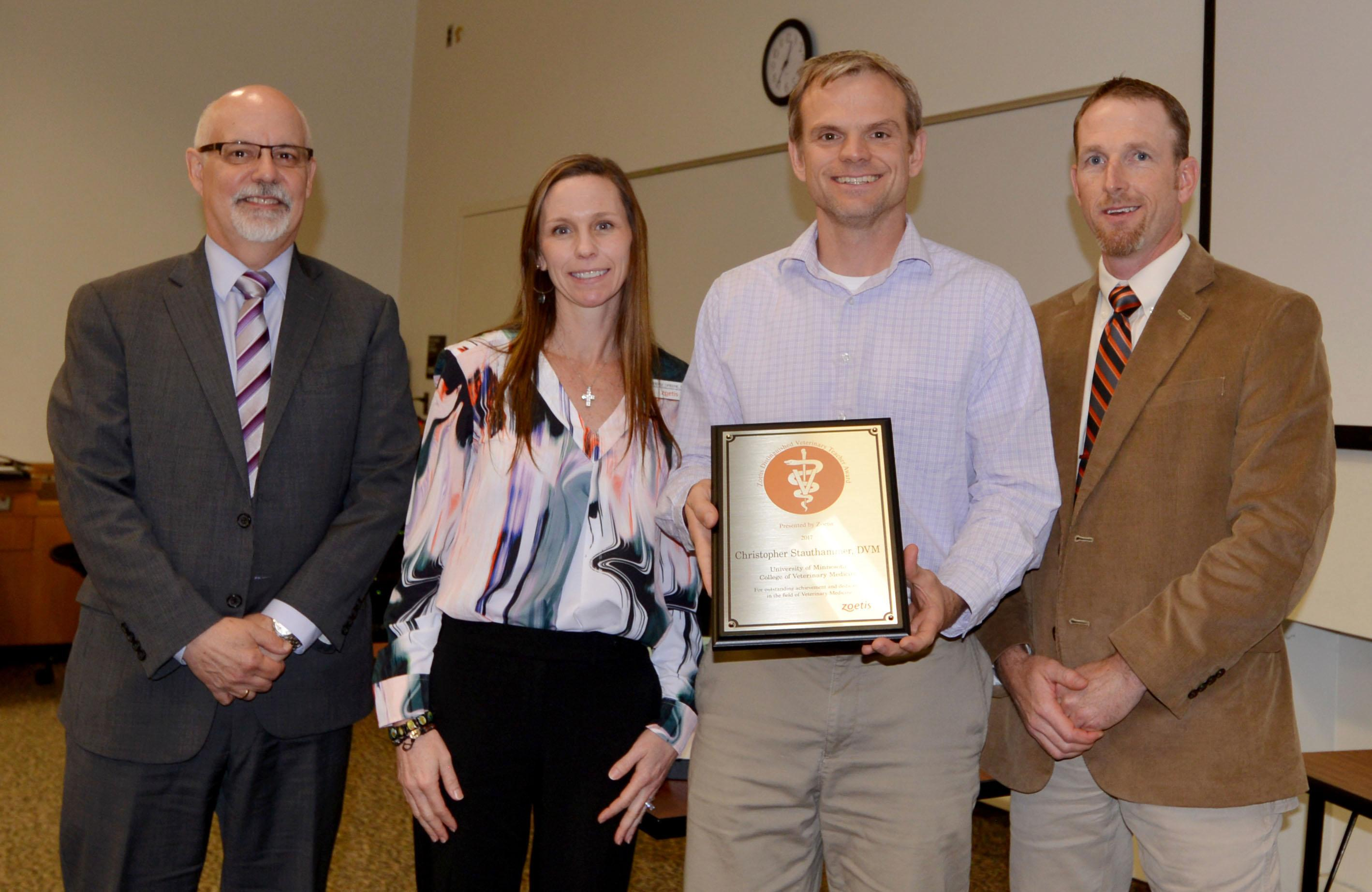 Dean Trevor Ames and representatives of Zoetis present Dr. Chris Stauthammer with the Zoetis Distinguished Teaching Award on Education Day