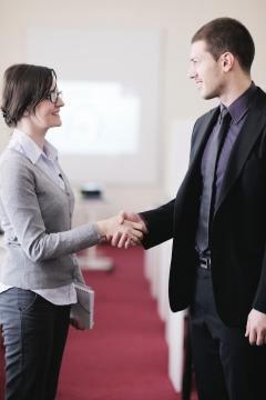 A man and woman shaking hands.